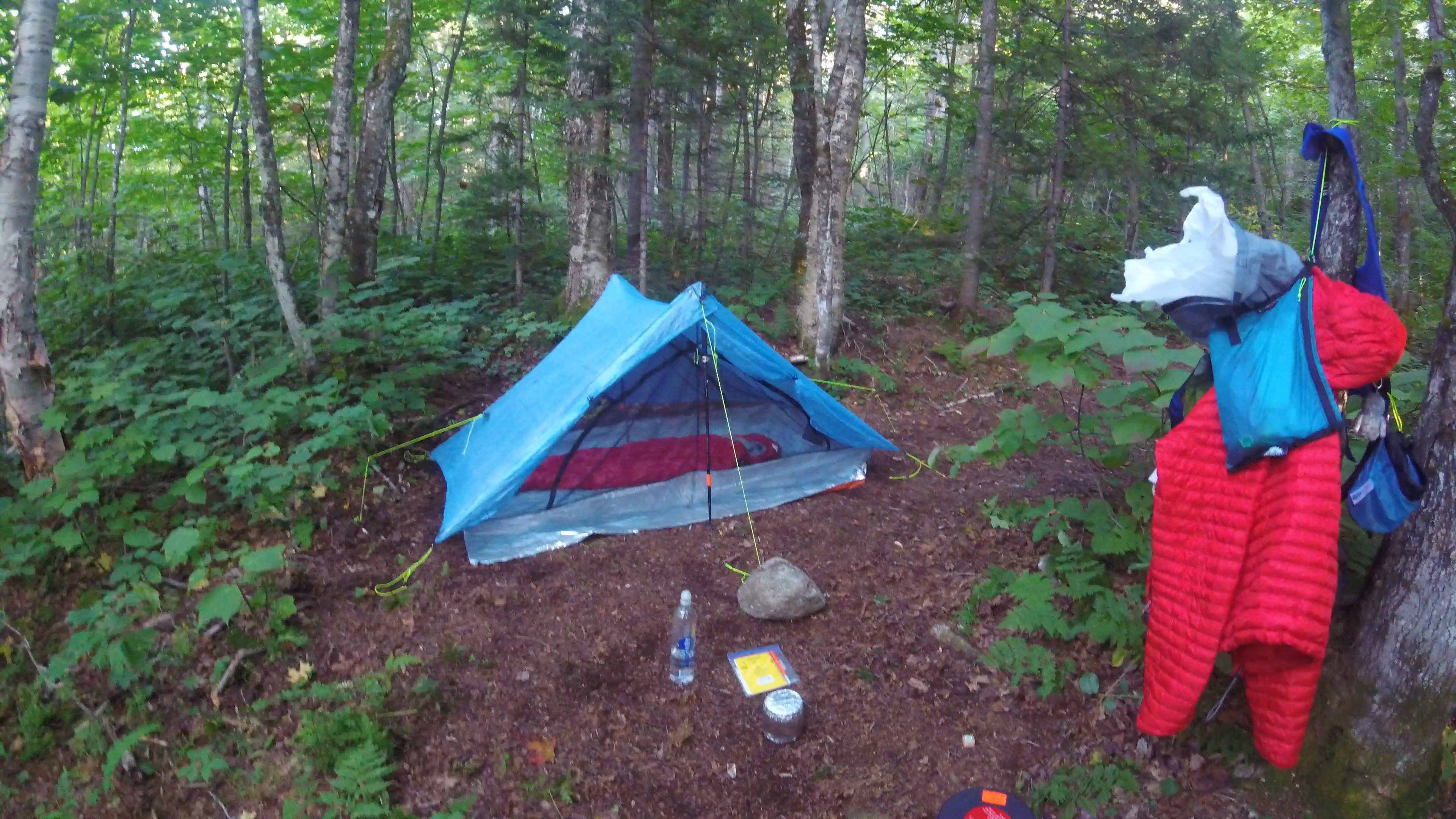 Tent setup at camp, large rock to keep stake secure